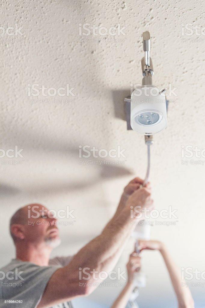 Home Renovations - Track Lighting Installation stock photo