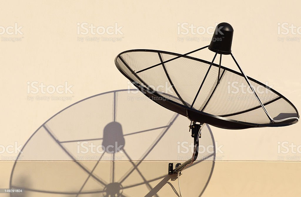 home sattellite dish and shadow stock photo