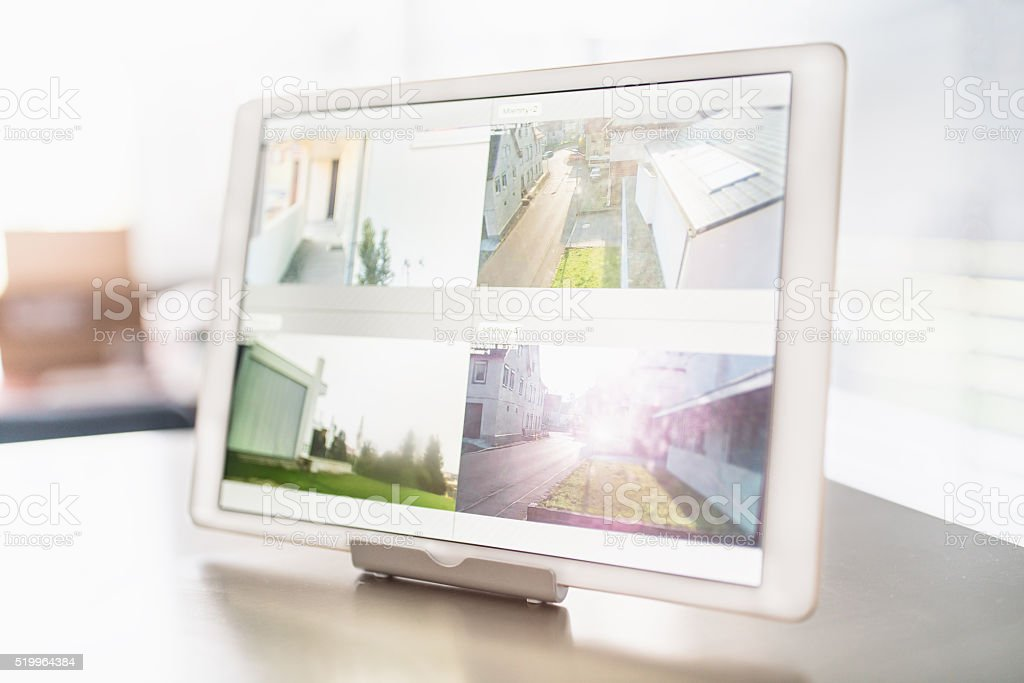 Home Security Cameras Digital Tablet stock photo
