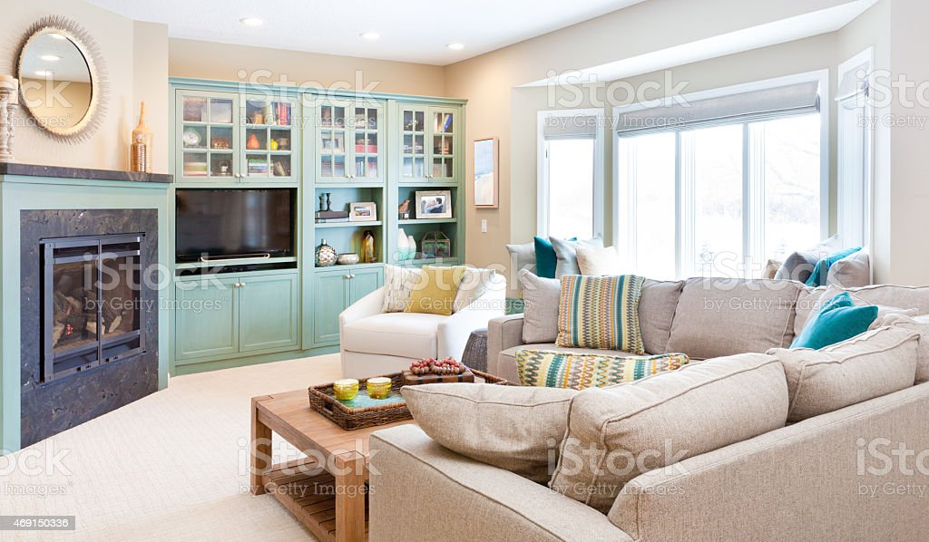 A contemporary classic home living room and cozy family room with...
