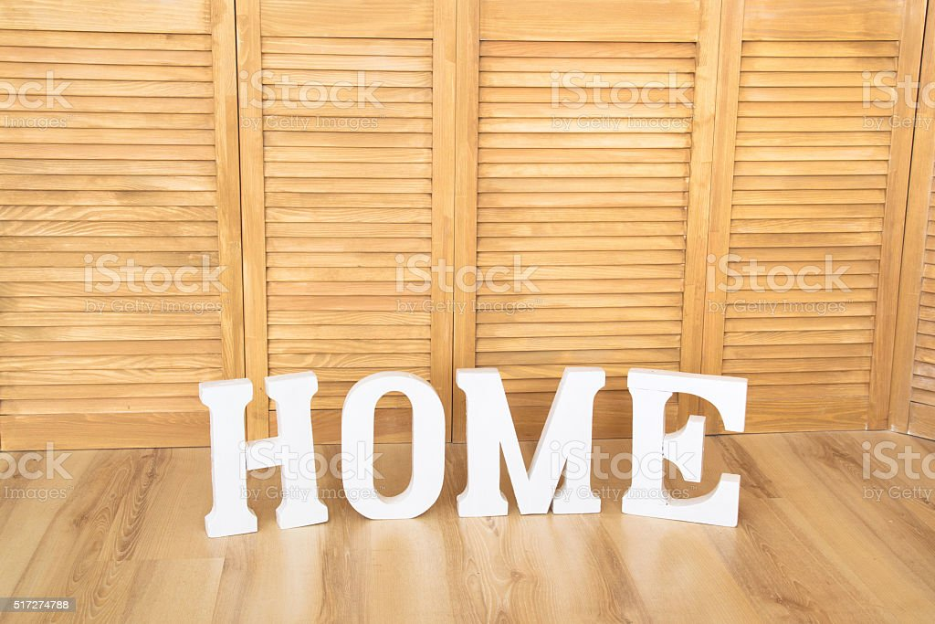 Home sign letters on wooden background stock photo