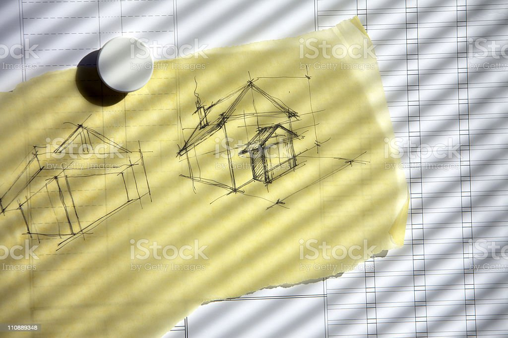 Home sketch on yellow paper stock photo