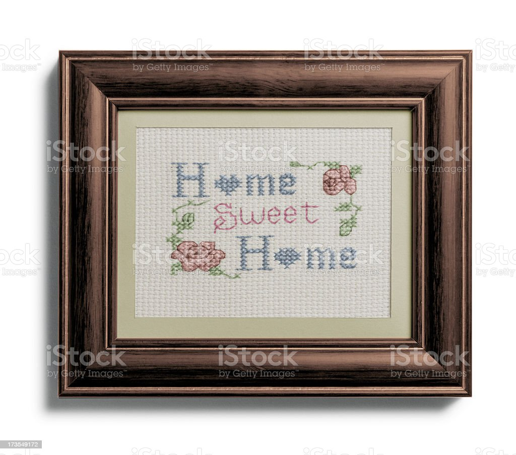 Home sweet home sampler in frame on white background royalty-free stock photo