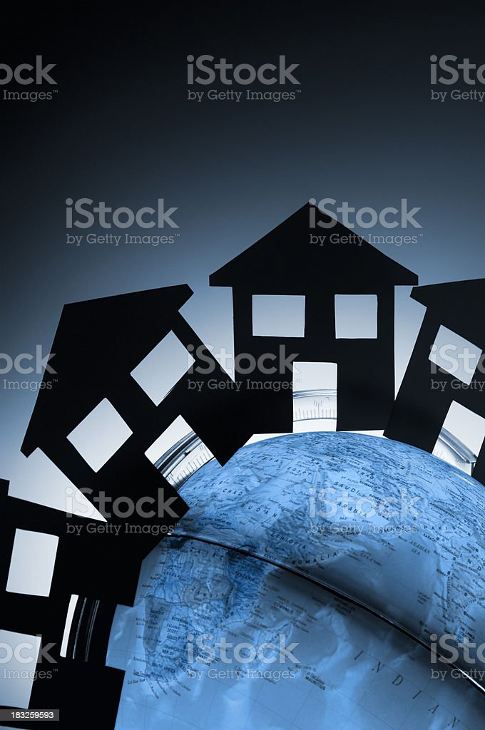 Home symbols connected together around a globe royalty-free stock photo