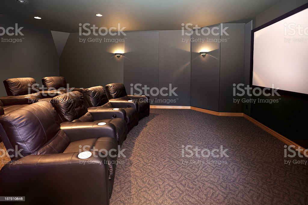 Home Theater Room, Leather Recliners, Movie Screen, HDTV, Surround Sound stock photo