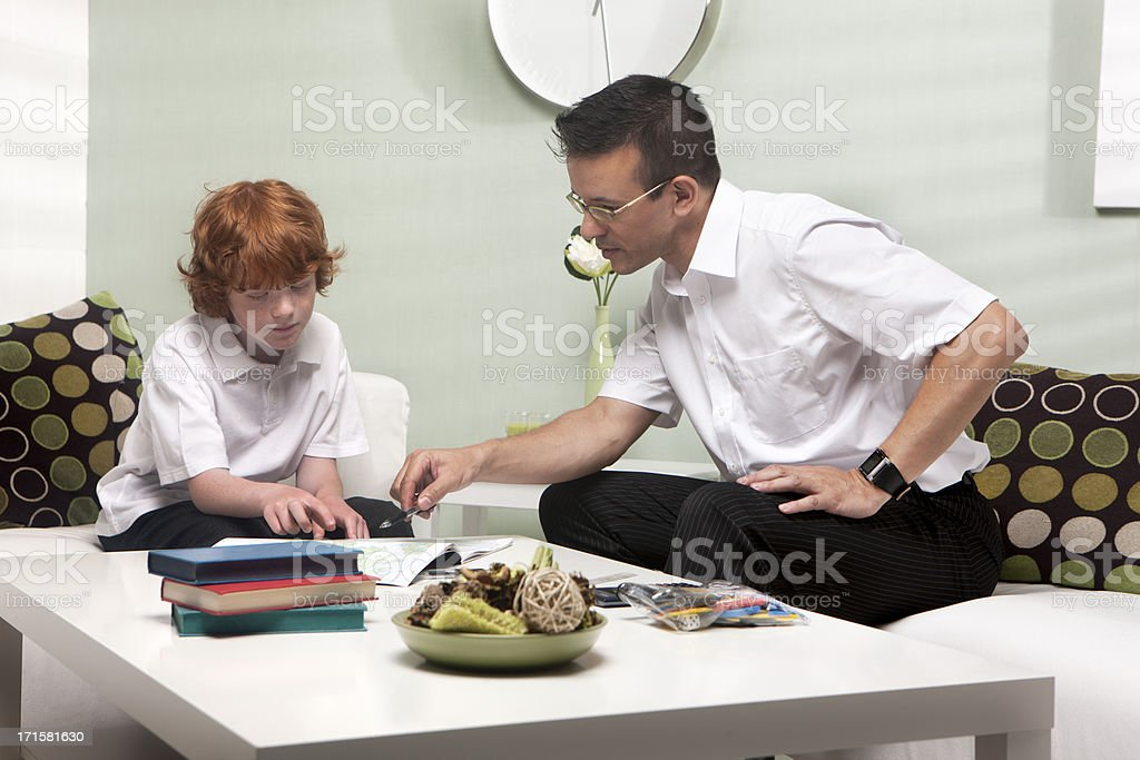 home tutor: teacher and student working together stock photo