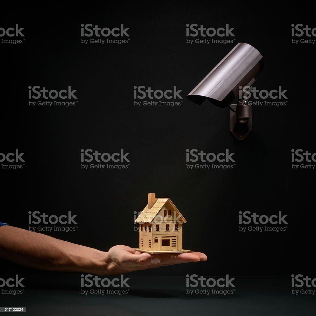 Home under video surveillance camera stock photo