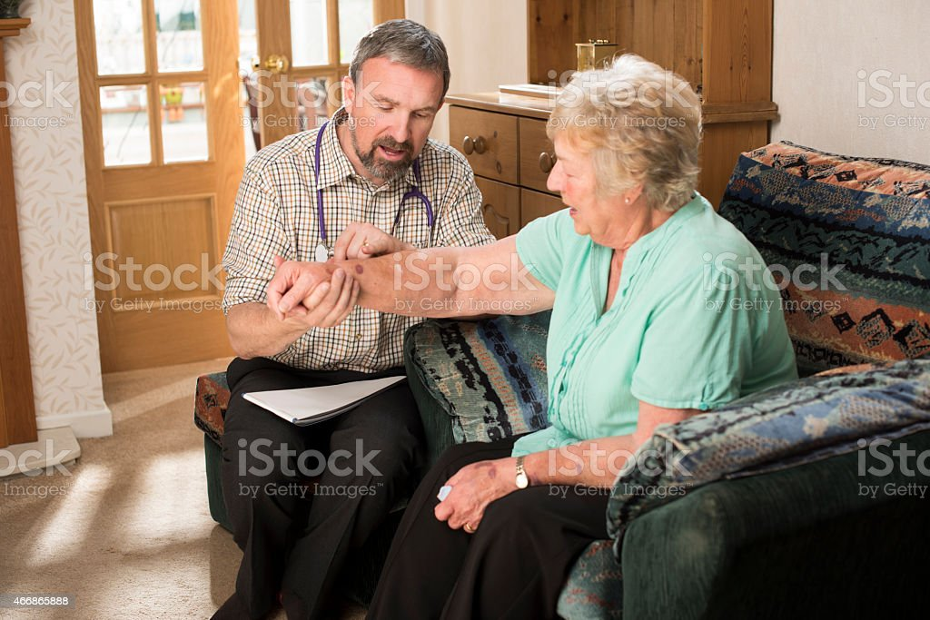 home visit doctor stock photo