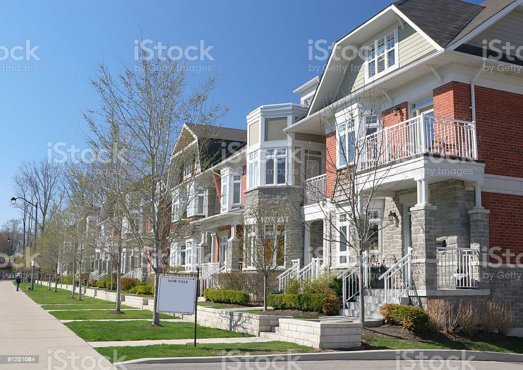 Home with a real estate sign on a residential Street royalty-free stock photo
