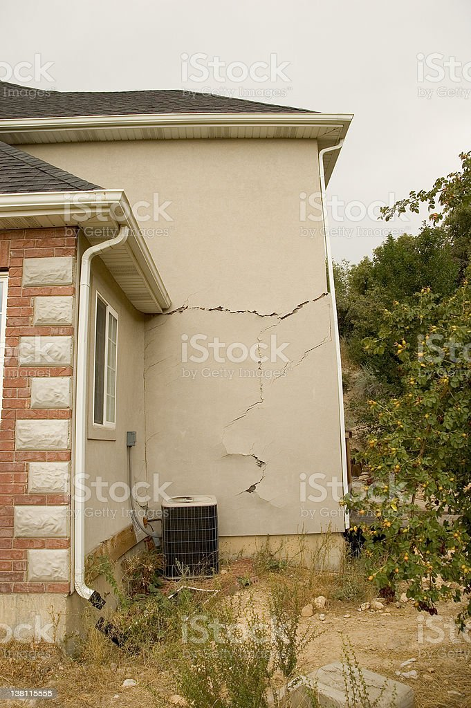 Home with Damage to Stucco Due to Shifting Foundation stock photo