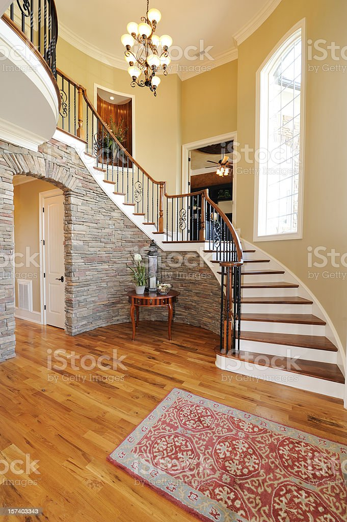 Home with large wooden stair case stock photo