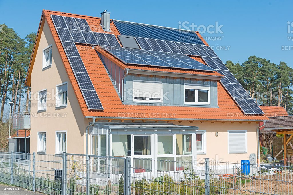 home with solar panels on roof stock photo