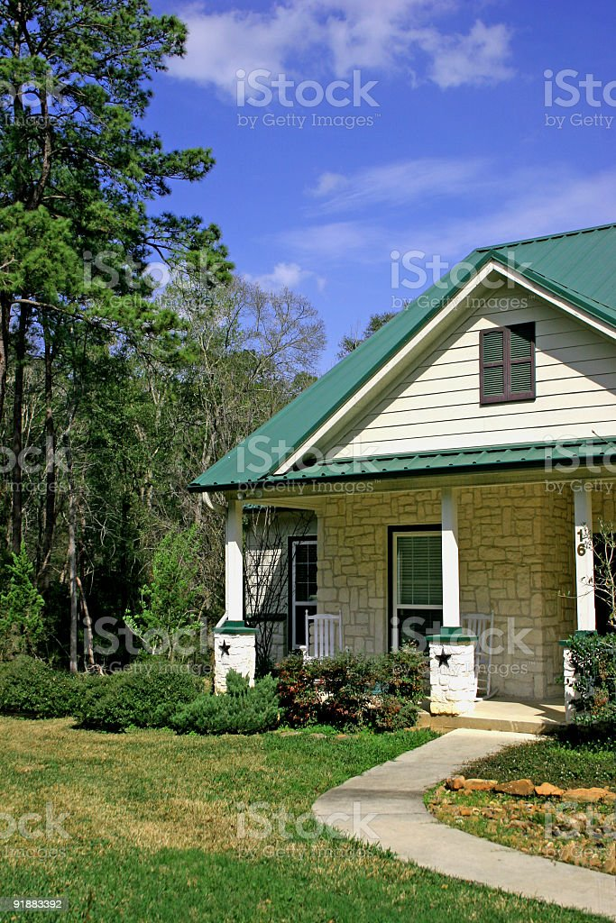 Home with stars on porch post. royalty-free stock photo