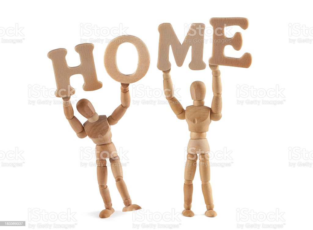 Home - wooden mannequin holding this word stock photo