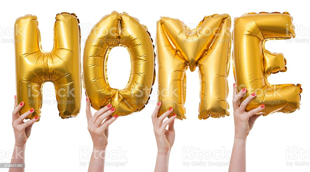 Home word made from gold balloons stock photo