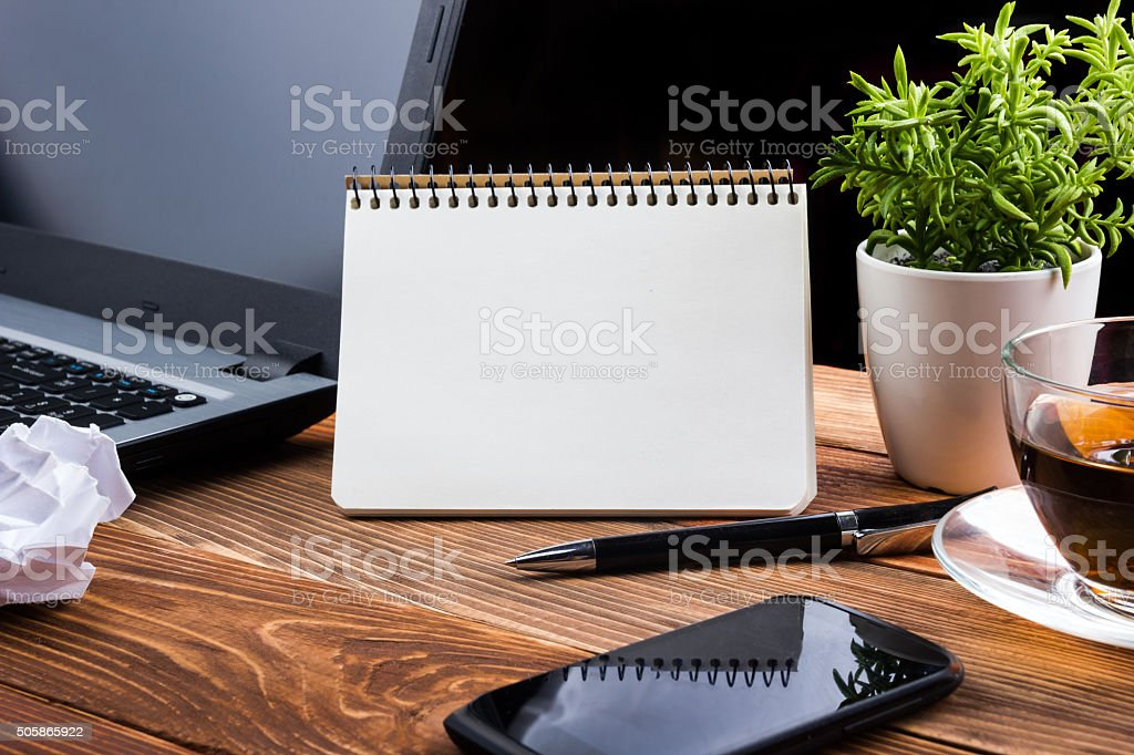 Home workplace with computer, blank notepad, copy space close up stock photo