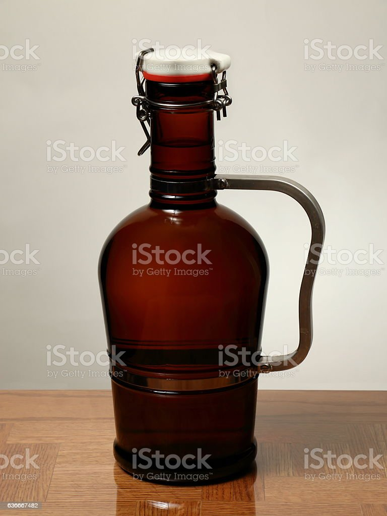 Homebrew Beer in Swing Top Growler with Handle stock photo