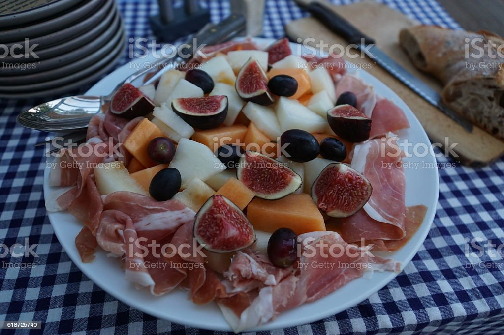 Homecooking. Antipasti and appetizer - Melon with ham and figs. stock photo