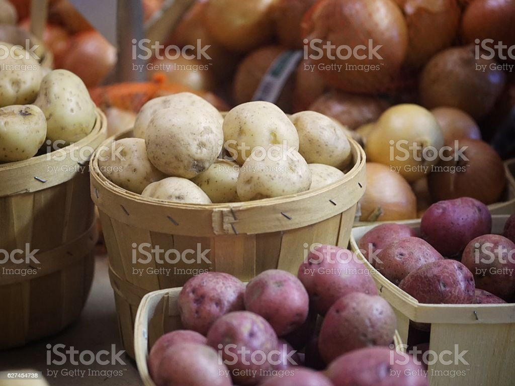 Homegrown Organic Farmer's Vegetable Market Yellow, Red Potatoes Harvest Baskets stock photo