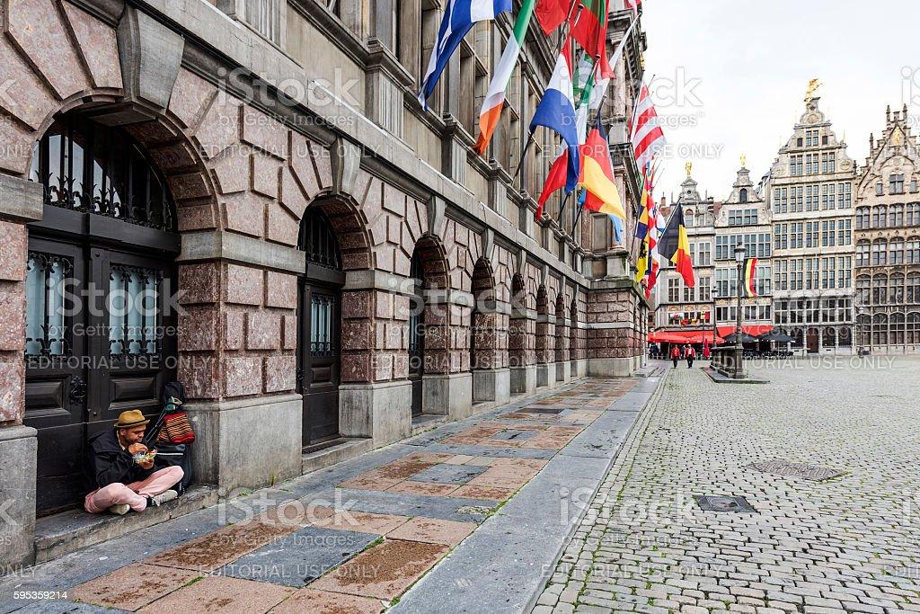 Homeless and City Hall in Antwerp, Belgium stock photo