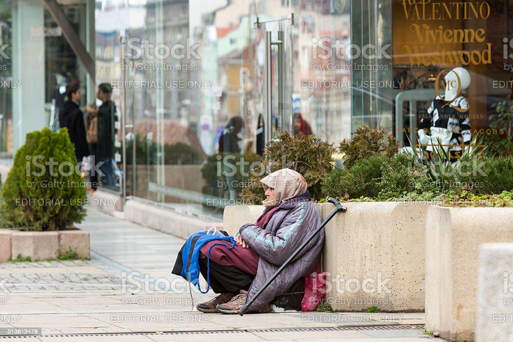 Homeless begging woman stock photo