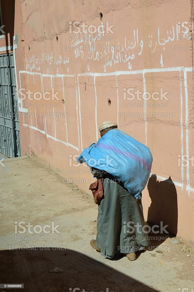 Homeless Berber Man Carrying Possessions stock photo