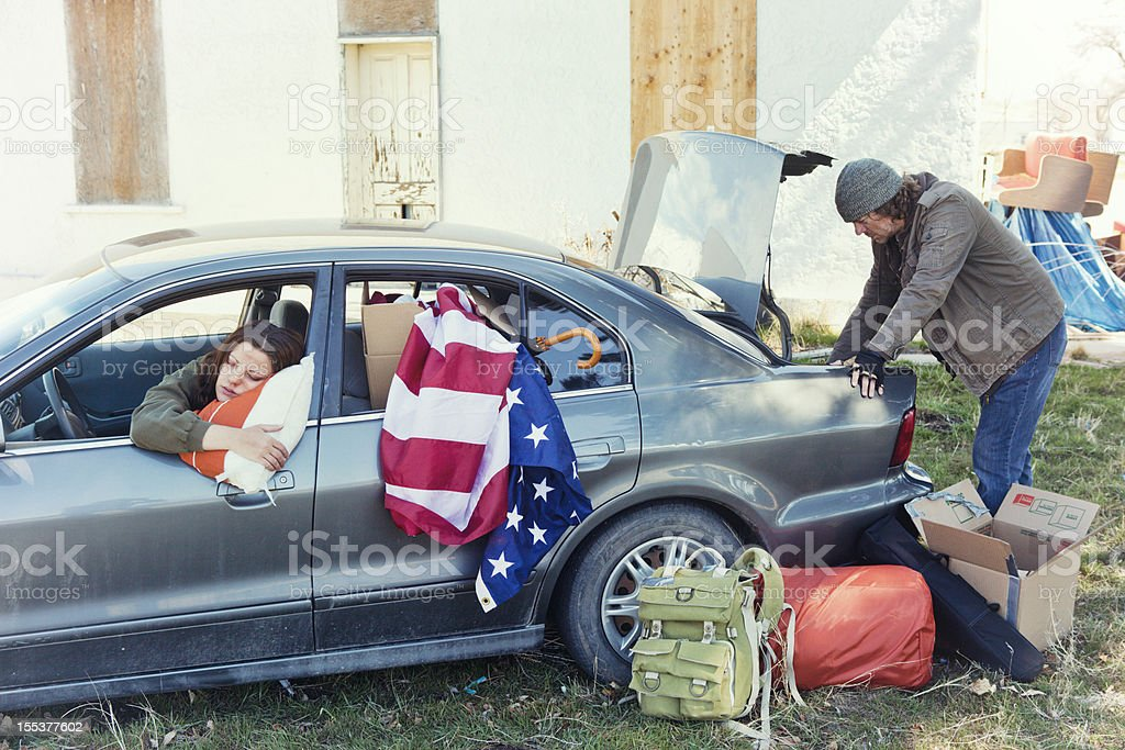 Homeless Couple Living Out of a Car stock photo