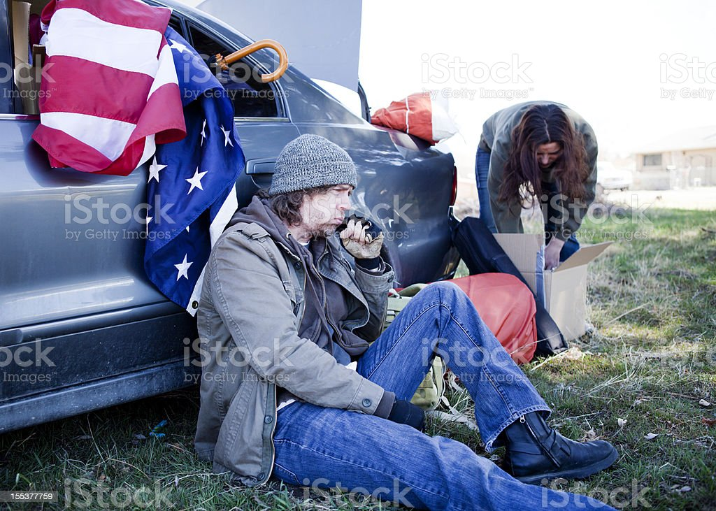 Homeless Couple Living Out of a Car royalty-free stock photo