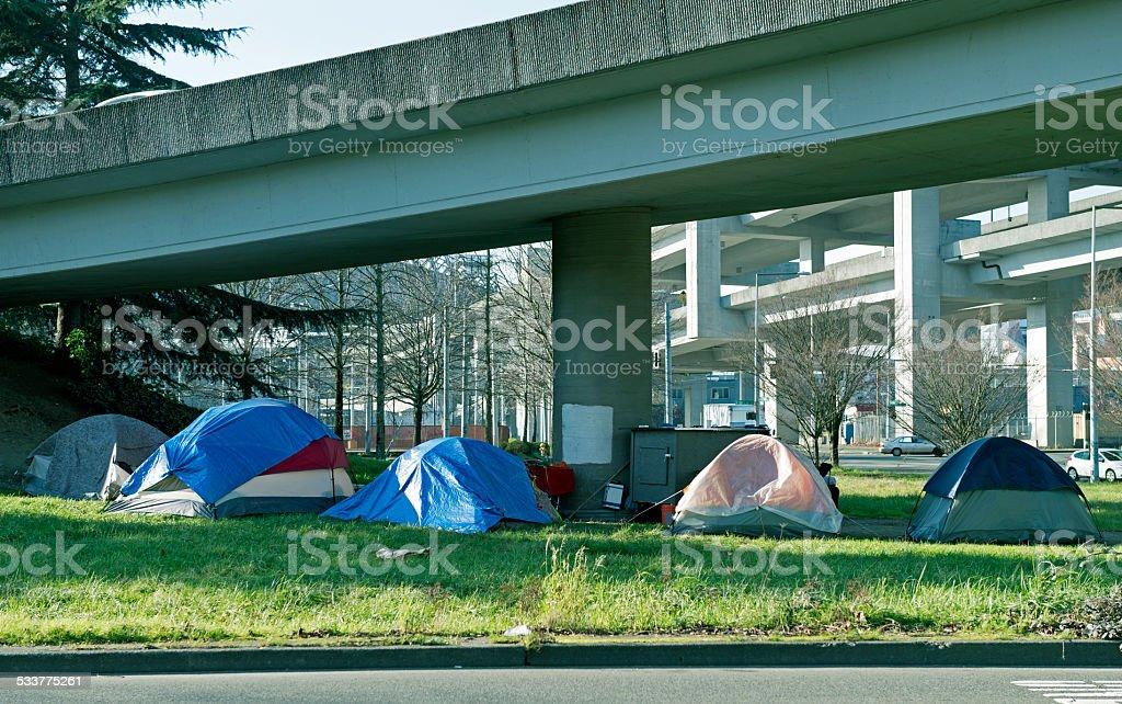 Homeless encampment below freeway in Seattle WA stock photo