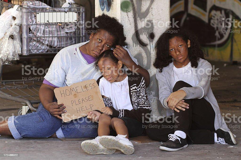 Homeless Family Eyes Down stock photo