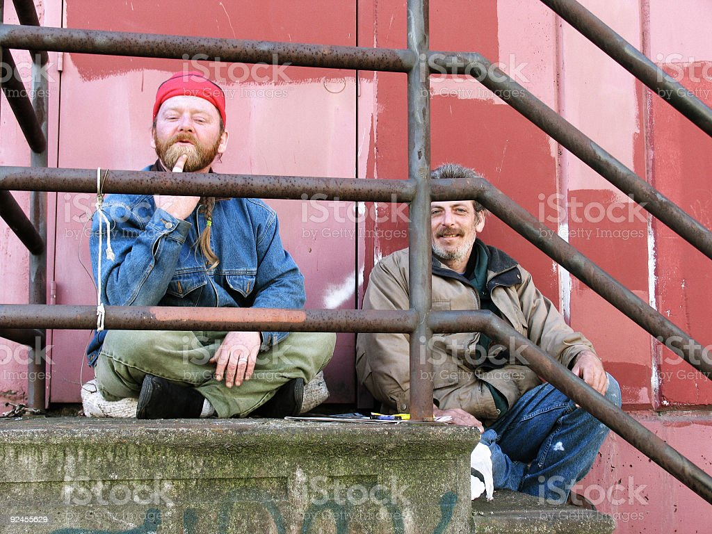 Homeless Friends Sitting on Old Stairs royalty-free stock photo