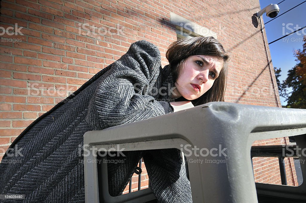 Homeless Girl Scrounges for Food stock photo