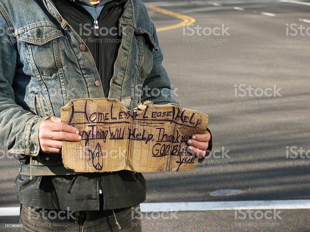 Homeless Guy with Dirty Denim Jacket and Sign royalty-free stock photo