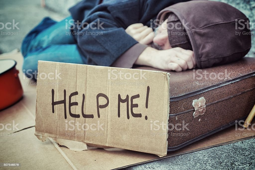Homeless Holding Cardboard stock photo