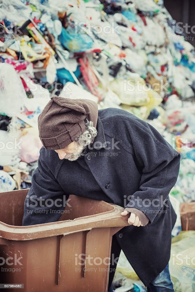 Homeless Looking for in a Garbage Dump stock photo