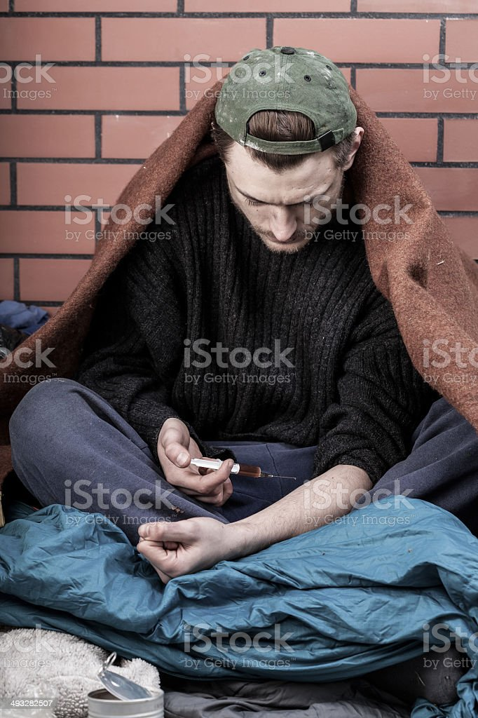 Homeless man addicted to drugs stock photo