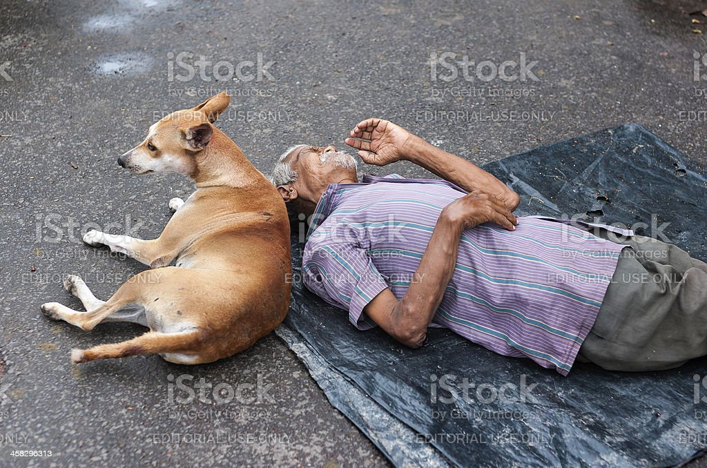 Homeless man and his dog, Kalighat, Kolkata, India. stock photo