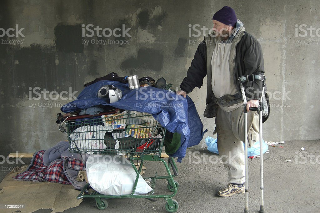 Homeless Man and Shopping Cart stock photo