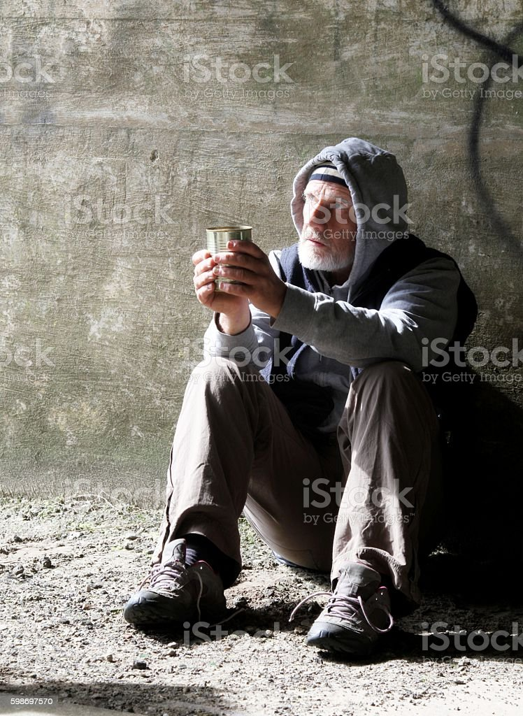 homeless man asking for money stock photo