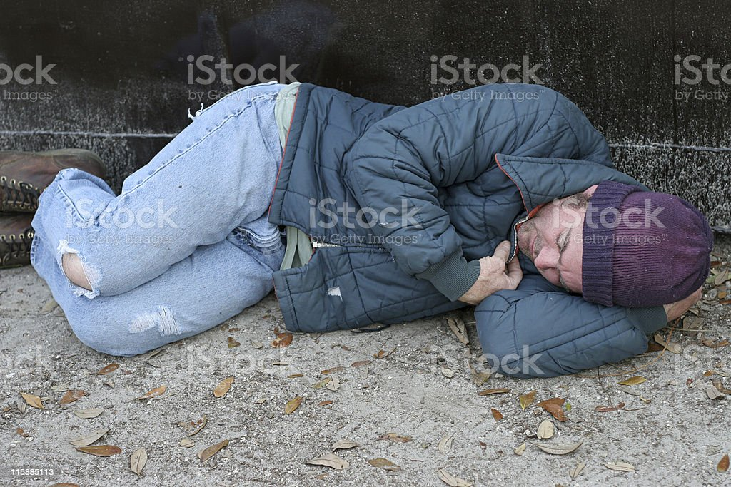 Homeless Man - Asleep By Dumpster royalty-free stock photo
