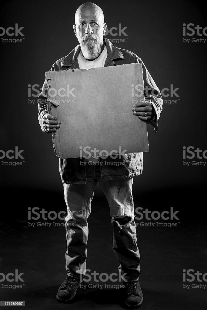 Homeless Man Begging with Cardboard Sign stock photo