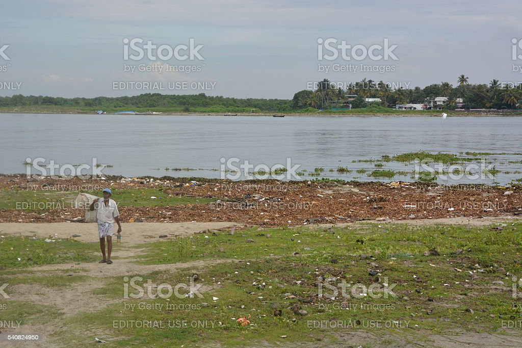 Homeless man carrying waste stock photo
