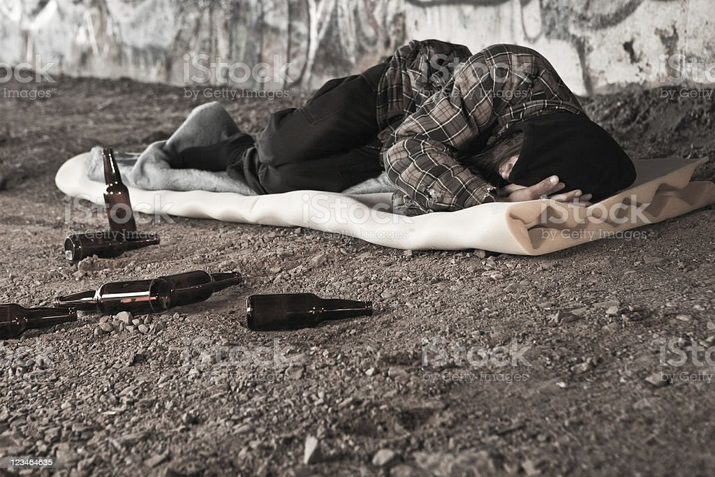 Homeless man drunk and passed out stock photo