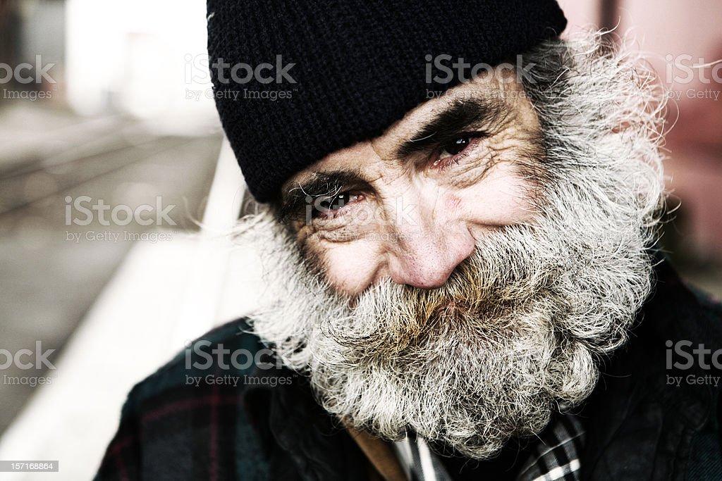 Homeless Man Giving a Humble Smile stock photo