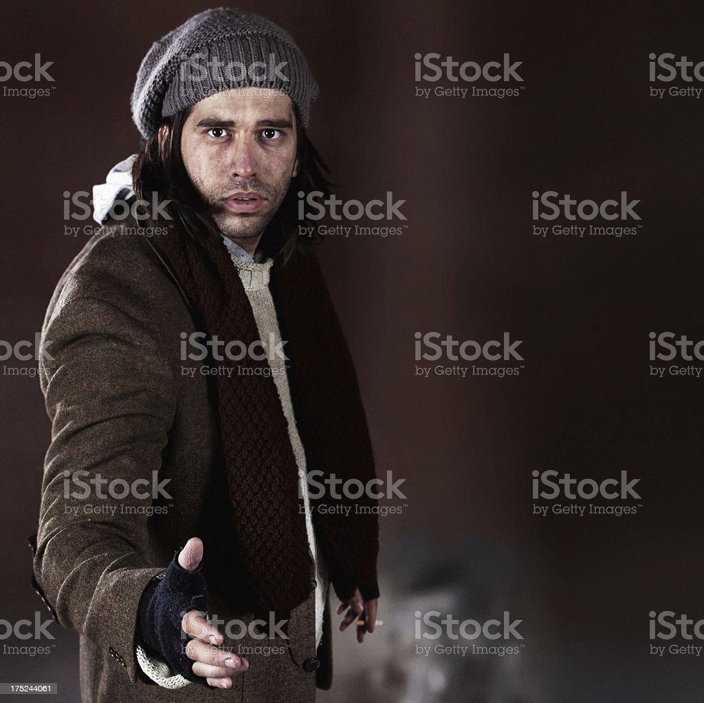 Homeless man giving his hand royalty-free stock photo