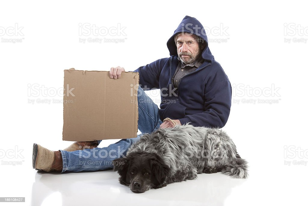 Homeless Man Holding Sign Isolated on White Background with Dog royalty-free stock photo