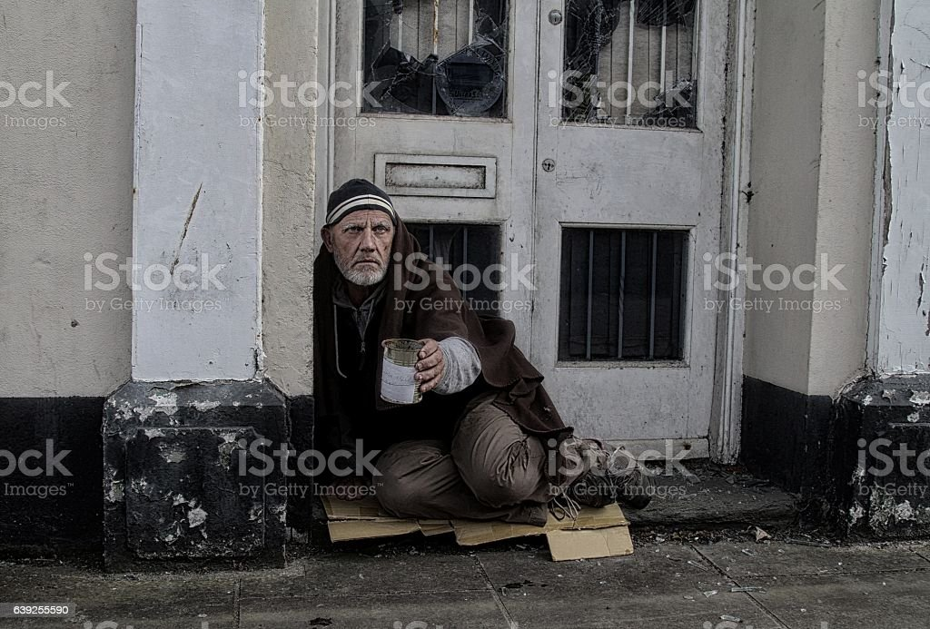 Homeless man in doorway stock photo