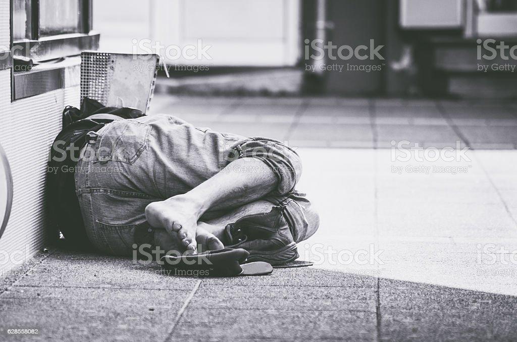Homeless man sleep on the street stock photo