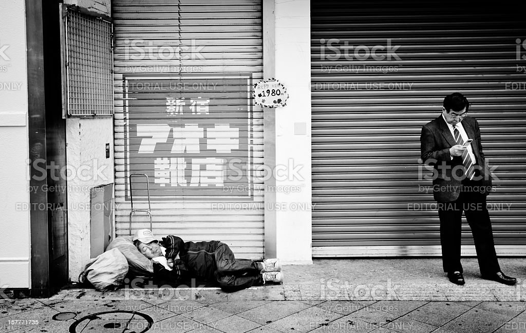 Homeless man sleeping in the streets of Tokyo stock photo