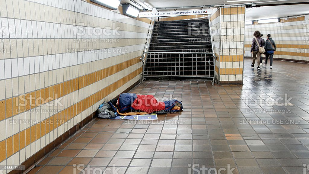 Homeless Man Sleeping in the Underground stock photo
